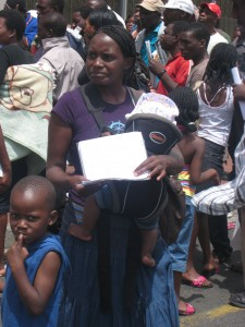 Mother and children waiting in long ZDP queue